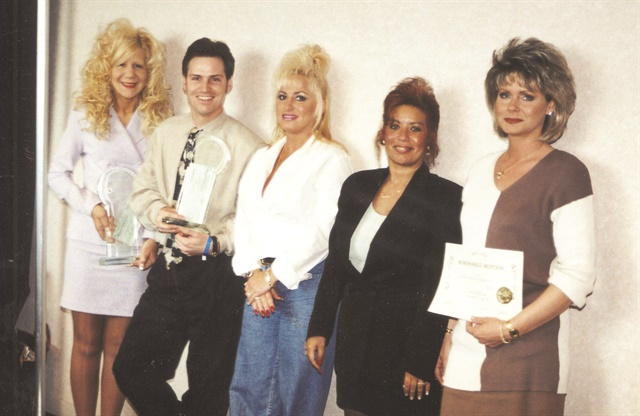 <p>Claudine Morgan, Bachik, and Victoria Sozio with their models in 1996.</p>