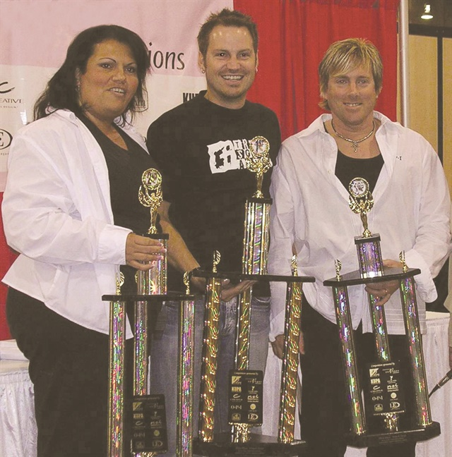 <p>Lorena Marquez, Tom Bachik, and John Hauk at a BBSI competition.</p>