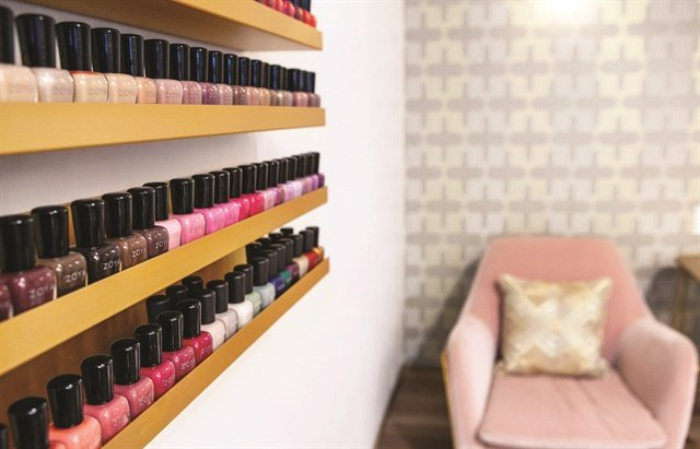 The salon offers services with polish, gel, acrylics, dips, and more.
