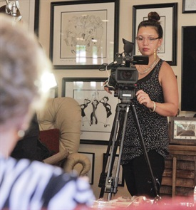 Adele Pham directs and films an interview with Tippi Hedren and five of the Original 20 Vietnamese nail techs for her upcoming documentary.