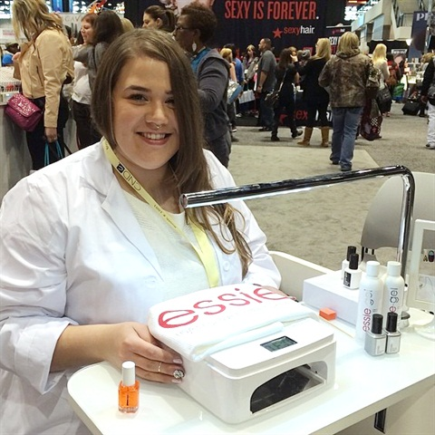 """<p>Nail artist Ashley Crowe (<a href=""""http://instagram.com/astrowifey"""">@astrowifey</a> on Instagram) shows off the new Essie LED lamp.</p>"""