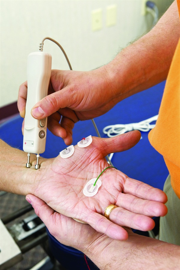<p>A chiropractor performs a nerve conduction study.</p>