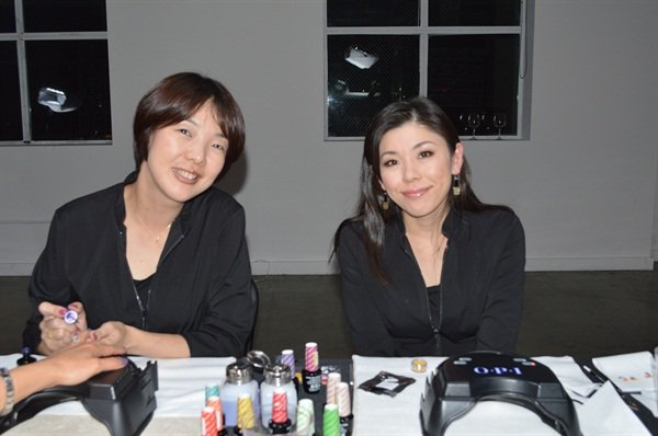 Tomoka Dei (right) from OPI Japan flew in to showcase her innovative nail styles.