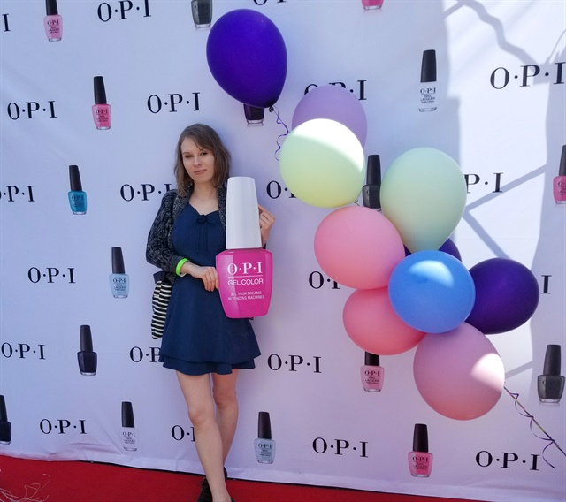 I posed with OPI's step-and-repeat and GelColor prop.