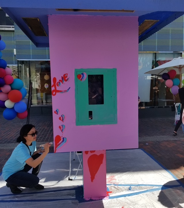 <p>A notice box was painted to add even more color to the area.</p>
