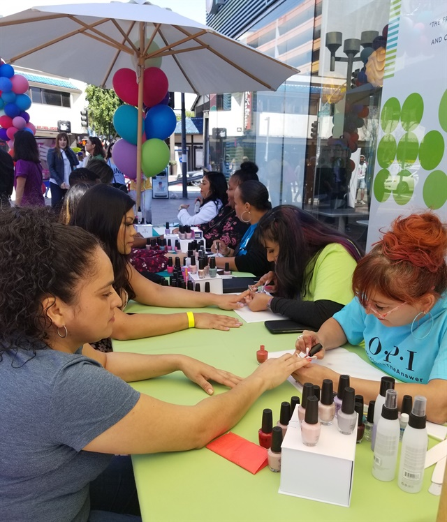 <p>OPI brought nail techs to give passersby colorful manis.</p>