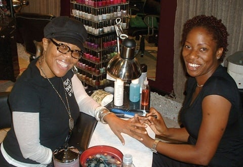 <p>Titilayo Bankole gives me a manicure at Giovanni's in Largo, Md.</p>