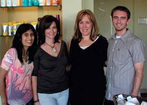 <p>From left to right: Sree, Shelby Passey, Lynn Weber, and Tim pose in front of Kaya Beauty's retail area.</p>