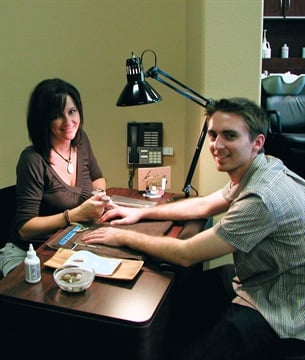 <p>Nail tech Shelby Passey works her magic on Tim.</p>