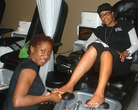 The pedicure room is separate from the rest of the salon, and white curtains offer additional privacy.
