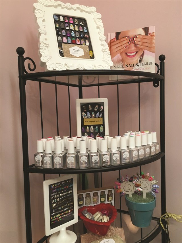<p>Nails are on display in frames and in plant jars.</p>