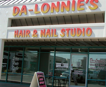 The highly reflective nature of Da-Lonnie's Hair & Nail Studio windows helps keep the salon cool and makes it feel like an escape once inside.