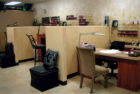 <p>These faux walls (the partitions between the manicure tables) were Jensen- Preato's biggest challenge when opening the salon; even though they are non-weight-bearing walls, she had to get a county license to install them.</p>