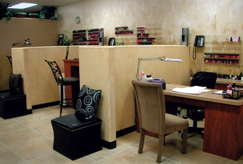 These faux walls (the partitions between the manicure tables) were Jensen- Preato's biggest challenge when opening the salon; even though they are non-weight-bearing walls, she had to get a county license to install them.