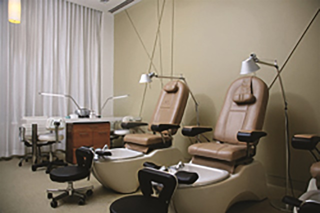 The manicure and pedicure room is comfortably appointed in neutral shades.