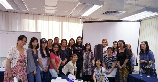 <p>Cuccio's Jacqueline Yeung leads a group of educators in Hong Kong.</p>