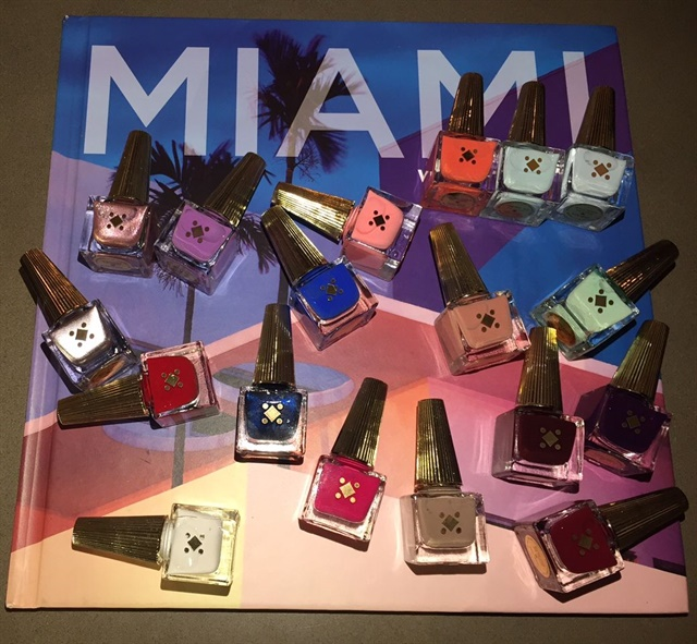 All models' nails were painted with Deco Miami Lacquer Polish.