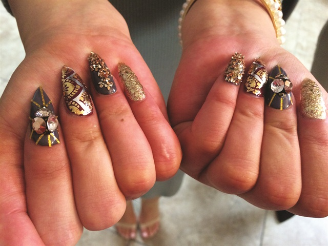 The nail looks presented at the fashion show reflected the fall/winter season and nail runway trends.