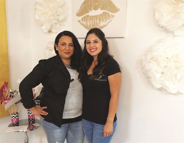 Vanessa Salinas (left), owner of Vanity Lash & Beauty Academy, with sister Zuniga.