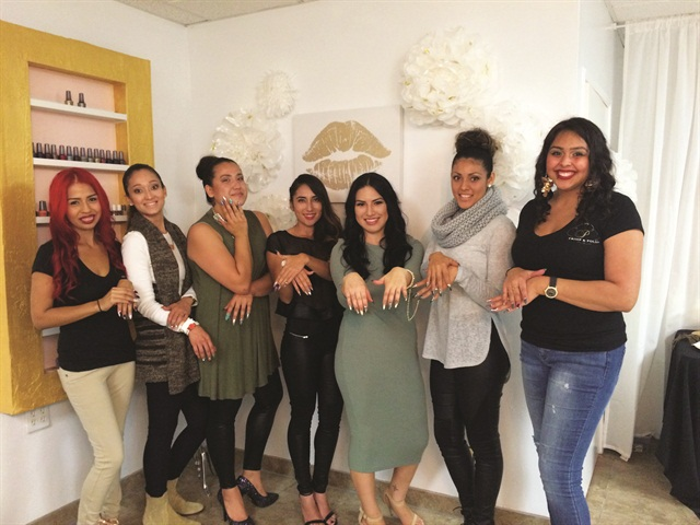 Models pose with nail techs Reyna Martinez (far left) and Jazmine Sanchez (far right). Nail techs wore similar runway-style nails as the models.
