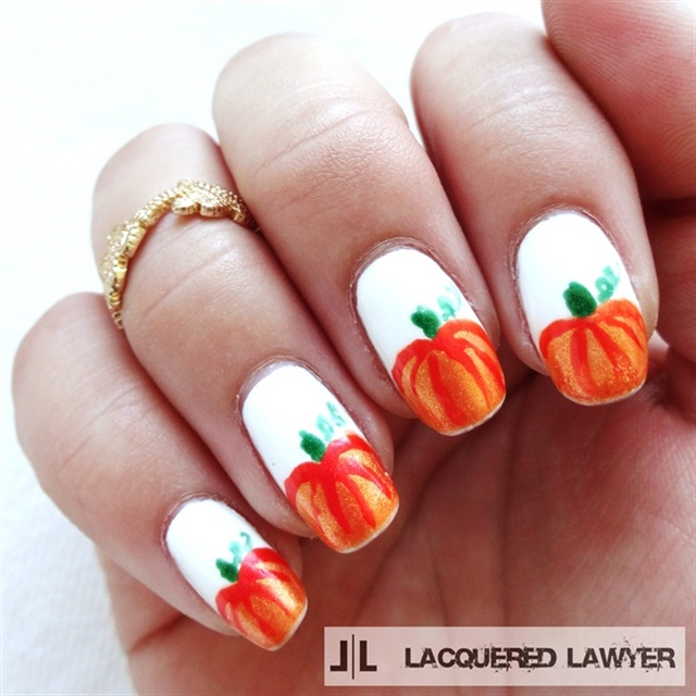 "<p>Via <a href=""http://nailartgallery.nailsmag.com/lacqueredlawyer/photo/378178/pumpkin-patch"">Nail Art Gallery</a></p>"