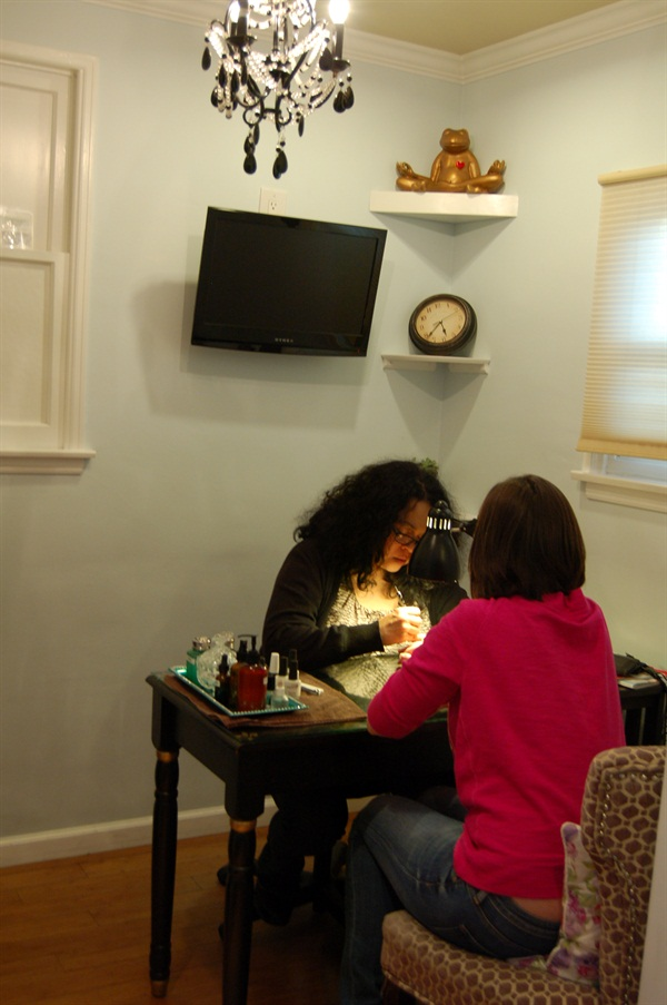 <p>Manicurist Connie with a client. </p>
