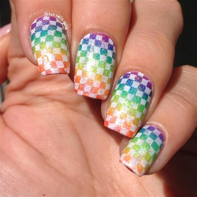 """<p><a href=""""http://nailartgallery.nailsmag.com/glittery_joy/photo/443456/checkered-rainbow"""">Via Nail Art Gallery</a>.</p>"""
