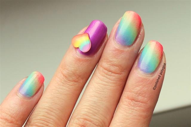 "<p><a href=""http://nailartgallery.nailsmag.com/polishpolyglot/photo/340054/rainbow-gradient-with-heart-decoration"">Via Nail Art Gallery</a>.</p>"