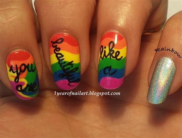 "<p><a href=""http://nailartgallery.nailsmag.com/daysofnailartnl/photo/360873/you-are-beautiful-like-a-rainbow"">Via Nail Art Gallery</a>.</p>"