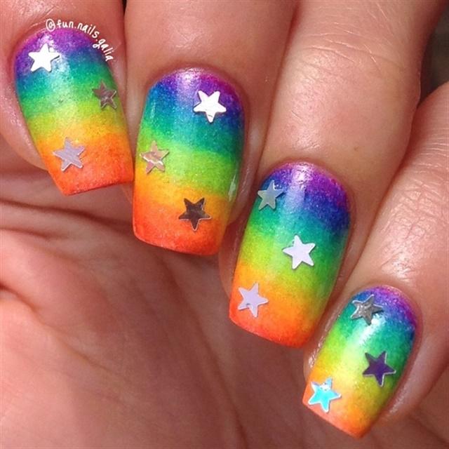 """<p><a href=""""http://nailartgallery.nailsmag.com/glittery_joy/photo/443457/rainbow-and-stars"""">Via Nail Art Gallery</a>.</p>"""
