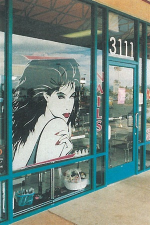 The large graphic image is eye-level, perfect for concealing a robbery in progress inside the salon.
