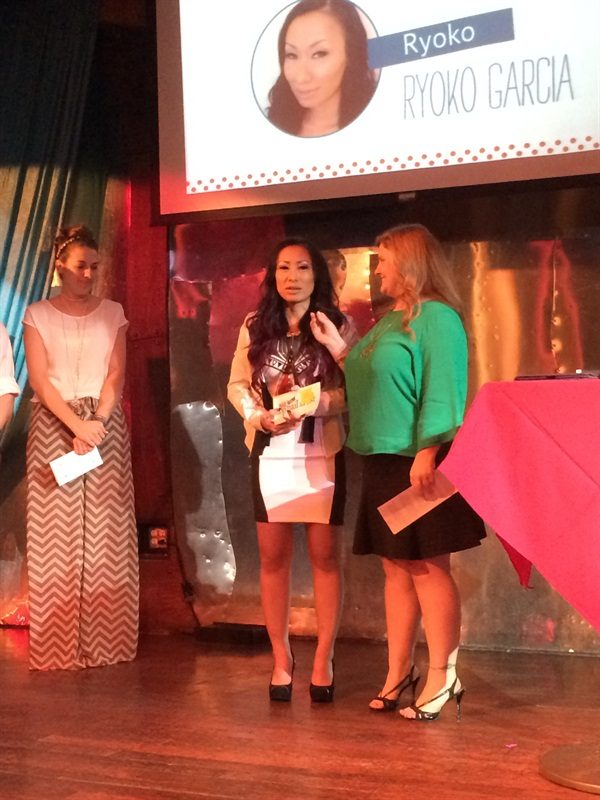 <p>NAILS editor Hannah Lee (right) announces the winner.</p>