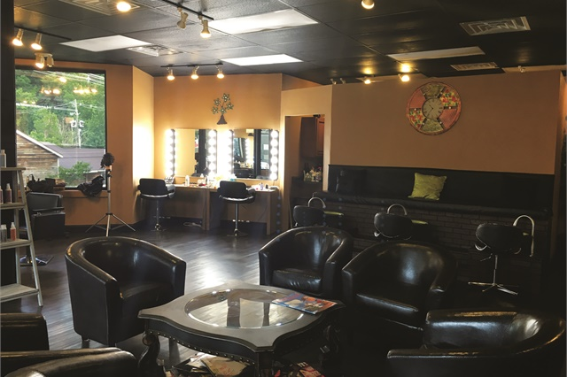 The salon is located on the second floor in Gatlinburg's historic Arts & Crafts Community. Clients can see the Smoky Mountains from the windows.