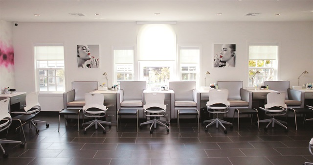 <p>The main room in Jessica &ndash; The Clinic is lined with gray leather client chairs and sleek side tables, all custom made by Belava.</p>