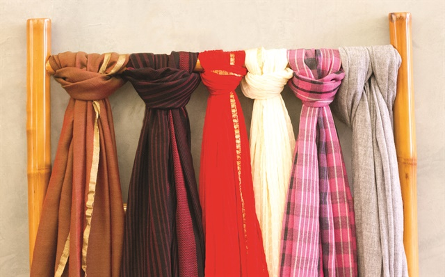 <p>Merchandise can be grouped around a single theme, like scarves. istock.com/Jannhuizenga</p>