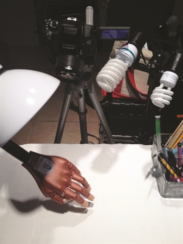 <p>Nail tech Janne Damas uses a DIY three-point lighting system to shoot her videos.</p>
