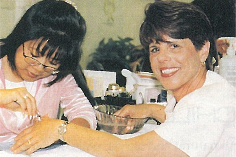 <p>Salon owner and Creative educator Dee Nguyen lavishes client Nancy Cassidy with a $10 manicure. Cassidy also donated the popcorn machine that helped raise a bonus $25.</p>