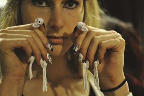 <p>Model backstage at the Libertine show wearing my skulls.</p>