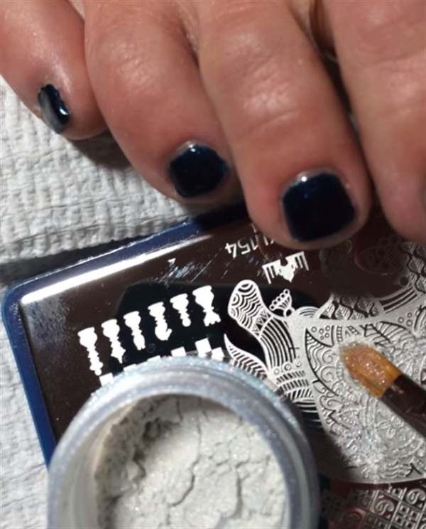 How-To: Stamping Plate with Powdered Pigments - - NAILS Magazine