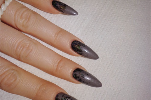 <p>2. Using  Revvolution add some strokes of color, starting from the cuticle. This color is darker than the base, so it goves the illusion of the night sky.</p>
