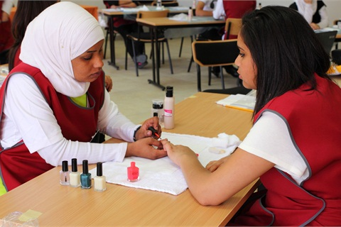 <p>A student practices her nail lesson. Living in a country with no official beauty professional licensing, salons and spa owners have devised a test that evaluates the competency of graduates.</p>