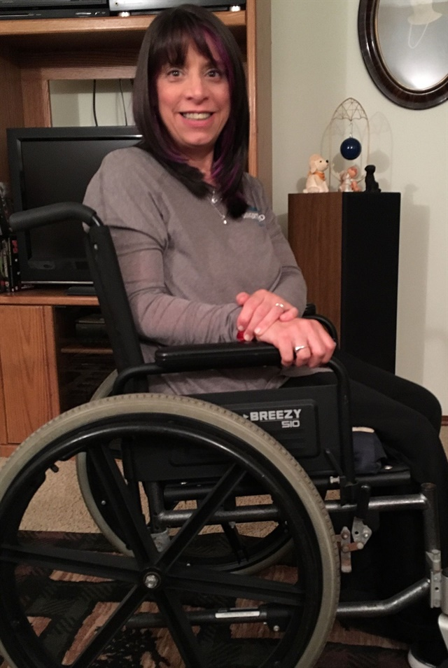 Nail tech Sue Cook has some balance issues that require use of a wheelchair.