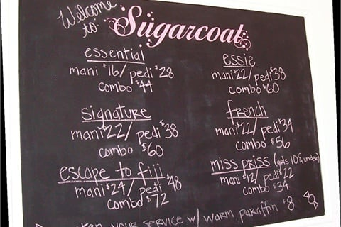 <p>A large chalkboard introduces the salon's different levels of service offerings, including its signature Escape to Fiji manicure and pedicure.</p>