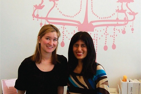 <p>Co-owner Colette Lievano and I stand in front of the iconic pink chandelier.</p>