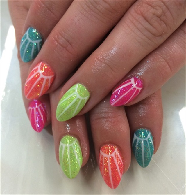 "<p>Via <a href=""http://nailartgallery.nailsmag.com/triciabaldwin/photo/366559/rainbow-sunshine"">Nail Art Gallery</a></p>"
