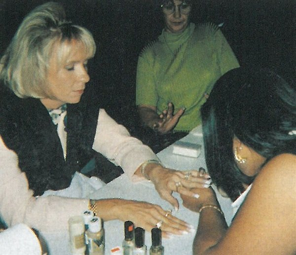 <p>Nail technician Charese Sailor introduces Tammy Taylor to the wonders of nail art at a Chicago nail show.</p>