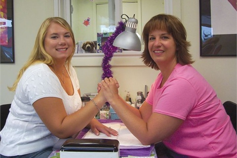 <p>Rhonda Kibuk (right) with a client.</p>