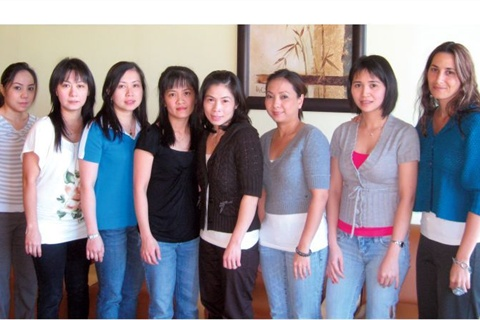Left to right are Lauren Harris, Lisa Wealer, Jill Cumpton, Ashley  DeGroush, Natalie Stone, Amanda Cox, Brooke Shephard, and Kala Bastion  (seated). Left to right are Que Le, Kim Thanh Vuong, Bich Phuong Nguyen,  Nancy Nguyen, Trang Mai, Phuong Le, Trang Hoang, and Roula Nassar.