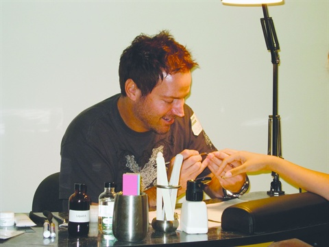 <p>Nail tech Tom Bachik likes to put a modern spin on the 1920s-inspired   almond nail. He spruced up Essie's Shifting Power with rhinestones in   the exact same shade for a flawless party look.</p>