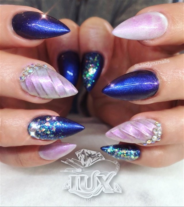 "<p><a href=""http://nailartgallery.nailsmag.com/jacques_nails99/photo/569282/pink-purple-unicorn-pigment"">Via Nail Art Gallery</a>.</p>"